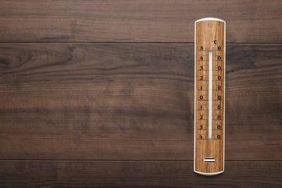 Wooden Thermometer On The Table