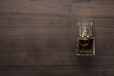 Perfume Bottle On The Wooden Table