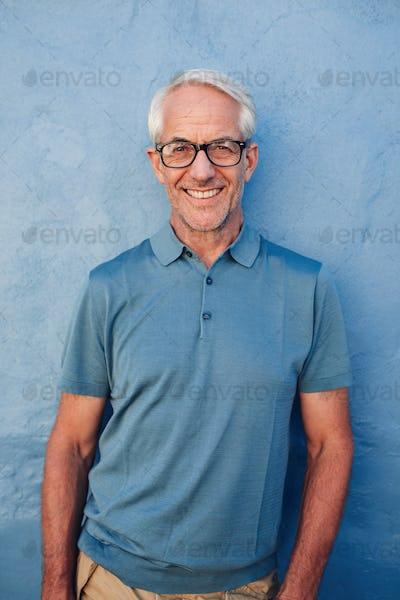 Handsome mature man smiling at camera