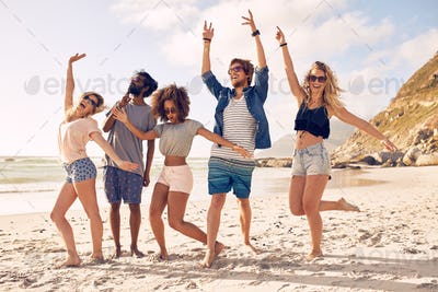 Group of friends having fun at beach