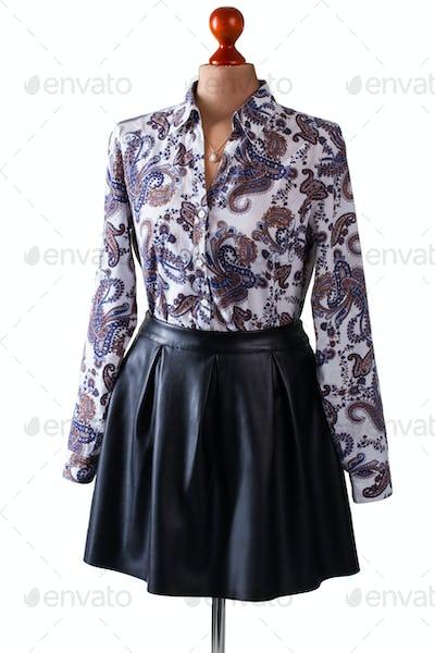 Black leather skirt and shirt.