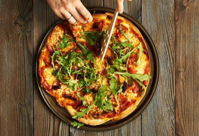 Home made pizza on wooden table