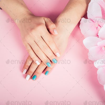 beautiful manicure. gel polish coating in white and turquoise, stamping.