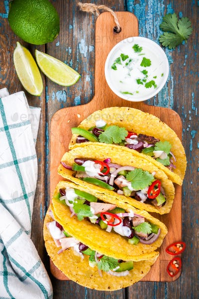 corn tacos with pork and vegetables