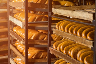 Bread stacked on the shelves.