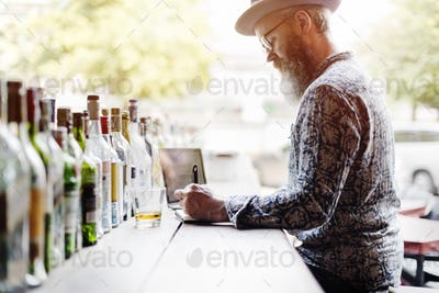 Senior Man Writing Working Liquor Alchohol Bar Concept