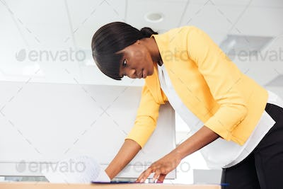 Businesswoman reading document in office