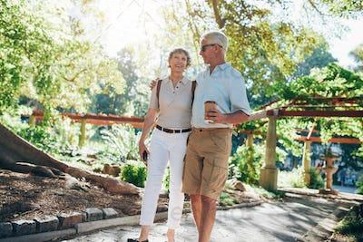 Loving senior couple enjoying a walk in the park