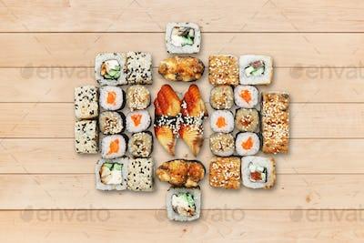 Set of unagi sushi and rolls at wood.