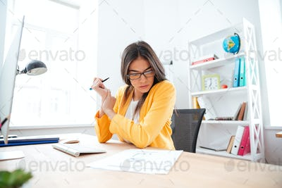 Businesswoman analysing document