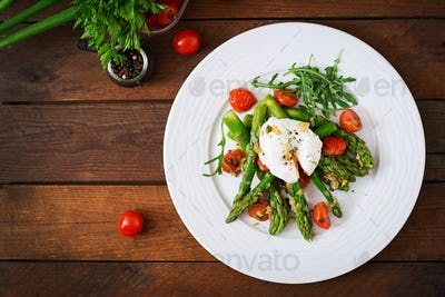 Salad of asparagus, tomatoes and poached egg. Top view