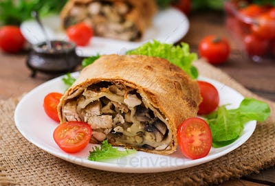 Homemade strudel with chicken, mushrooms, cheese and parsley