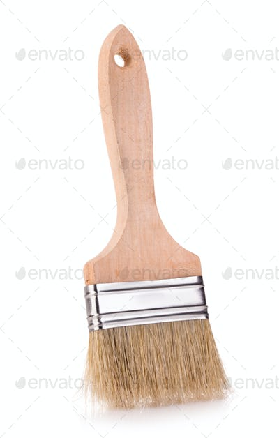 Wooden paint brush close-up on white background.
