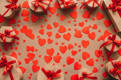 Background of gift boxes and red hearts.
