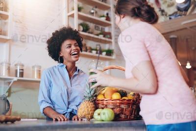 Juice bar owner talking to female customer