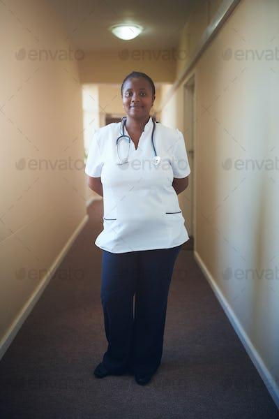 Female doctor nurse standing in corridor
