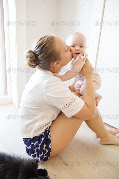 Portrait of happy loving mother and her baby at home