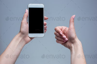 Closeup shot of a woman typing on mobile phone