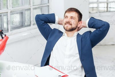 The male office worker resting