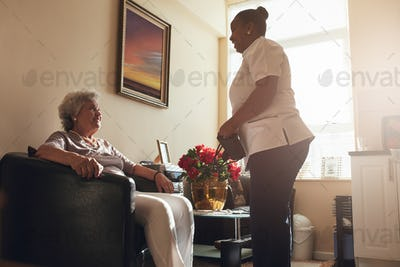 Senior woman at home with female caregiver
