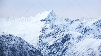 Snowy mountains in cold arctic environment