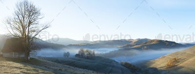 Small cottage in the mountains-panoramic view