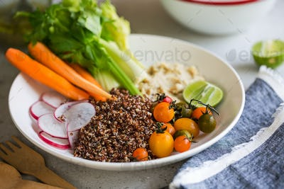 Quinoa with celery,carrot and hummus salad