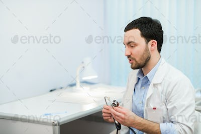 Doctor in consultation with patient sitting in front of him
