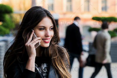 Woman phone talking. Closeup young happy beautiful smiling girl lady talking on smartphone over