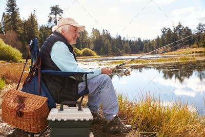 Senior man fishing in a lake, Big Bear, California, close-up