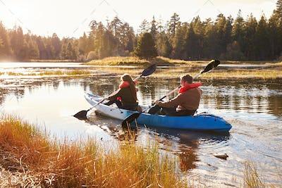 Couple kayaking on lake, back view, Big Bear, California