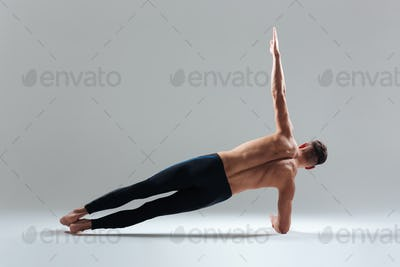 Young man doing yoga exercise