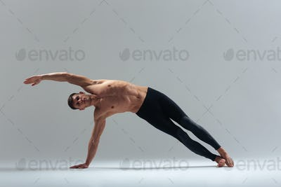 Fitness man doing stretching exercise