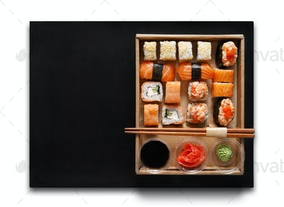 Set of sushi maki and rolls at box isolated.