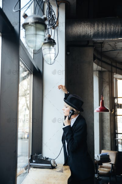 Stylish pretty blonde girl talking on the phone