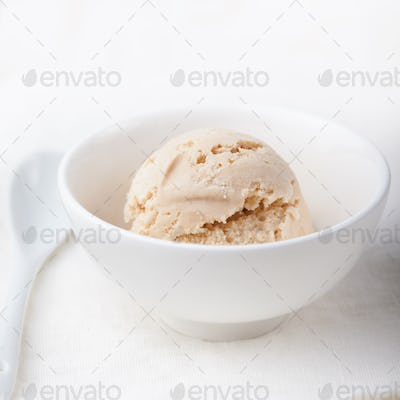 Ice cream with Earl grey tea flavor in white bowl