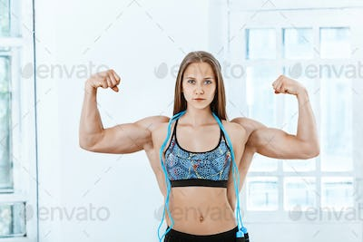The fit strong man and a woman posing on white background