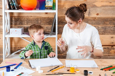 Mother and his cute little son painting together