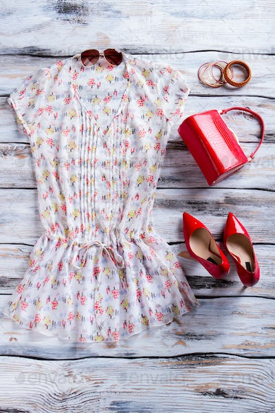 Blouse and red heel shoes.