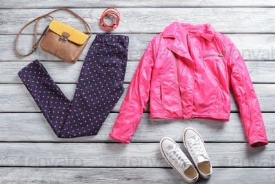 Pink jacket with dotted trousers.