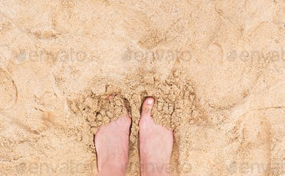 Vacation holidays. Woman feet closeup of girl relaxing on beach in sunny summer day.