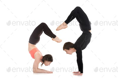 Yogi couple in yoga Scorpion Pose