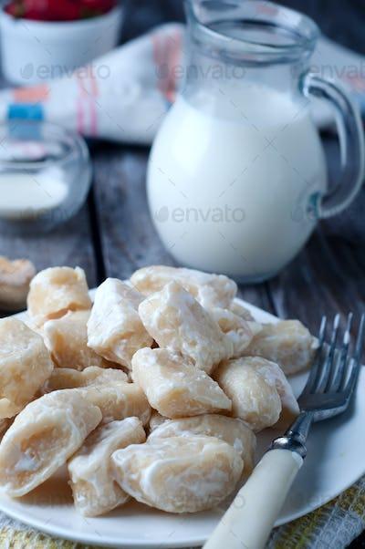 lazy pierogi. cottage cheese dumplings with sour cream