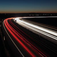 Night highway (Cars in a rush moving fast on a highway  (speedwa
