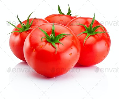 Juicy ripe red tomatoes isolated on white background
