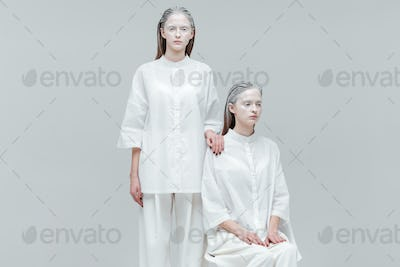 Two women in white clothes