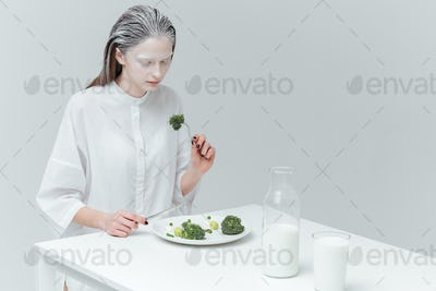 Woman eating healthy food at the table