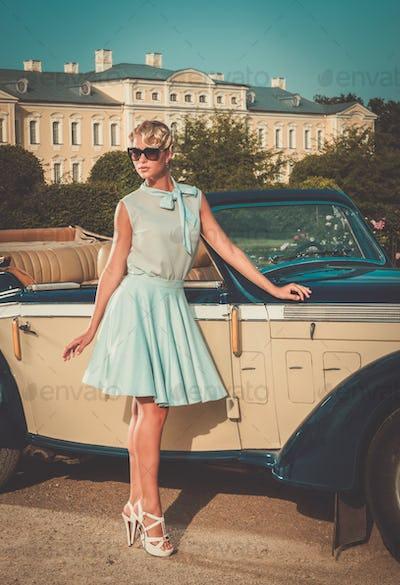 Beautiful lady near classic convertible