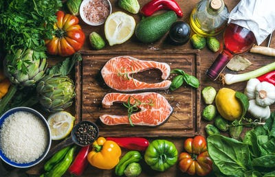 Raw uncooked salmon fish with vegetables