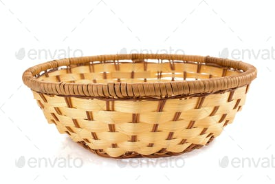 wicker plate on white background